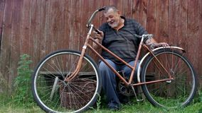 Senior man is being unhappy about very old rust bicycle and ancient wicker basket stock video