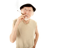 Senior man in beret with cigarette Royalty Free Stock Photo
