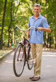 Senior man with bicycle Royalty Free Stock Photos