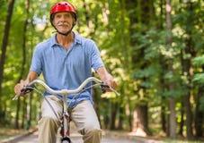 Senior man with bicycle Stock Photo