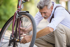 Senior man with bicycle Royalty Free Stock Photo