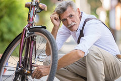 Senior man with bicycle Royalty Free Stock Images