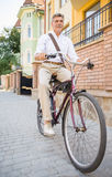 Senior man with bicycle Royalty Free Stock Image