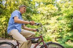 Senior man with bicycle Stock Photos