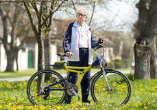 Senior man with bike Royalty Free Stock Image