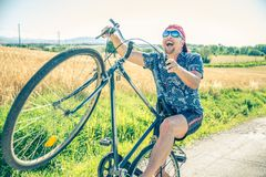 Senior man on bike Stock Photography