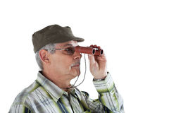 Senior man with binoculars Royalty Free Stock Photos