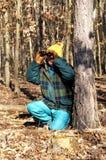 Senior man with binoculars Royalty Free Stock Images