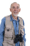 Senior man with binoculars Stock Photography