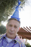 Senior Man With Birthday Cap Stock Image