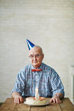Senior man at birthday party Stock Photography