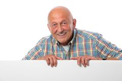 Senior man with a blank board. Happy smiling senior man holds a blank board Royalty Free Stock Photo