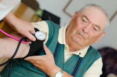 Senior man blood pressure Stock Photos