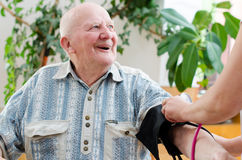 Senior man blood pressure Stock Photo