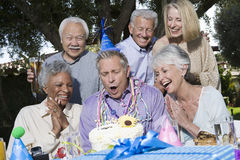 Senior Man Blowing Candles Royalty Free Stock Photo
