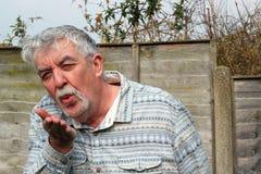 Senior man blowing a kiss. royalty free stock images