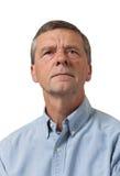 Senior man in blue shirt looks pensive Stock Photography