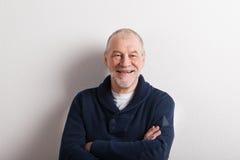 Senior man in blue woolen sweater, studio shot. Stock Photography