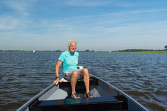 Senior man in boat Stock Photo