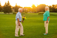 Senior man with a bouquet. Royalty Free Stock Photography