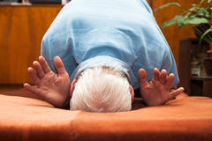 Senior man bowing Stock Images