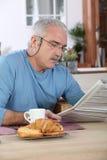 Senior man at breakfast Royalty Free Stock Photo