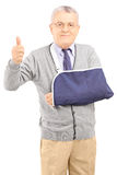 Senior man with broken arm giving thumb up Royalty Free Stock Photo