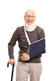Senior man with a broken arm smiling Stock Image