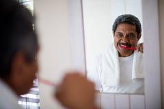 Free Senior Man Brushing Teeth In Bathroom Royalty Free Stock Image - 84098586