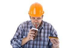 A senior man builder has a lunch with coffee and cake Royalty Free Stock Photo