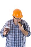 A senior man builder has a lunch with coffee and cake Royalty Free Stock Images