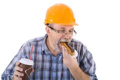 A senior man builder has a lunch with coffee and cake Stock Photo