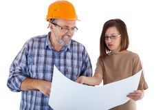 A senior man builder and young engineer looking at the project Royalty Free Stock Photo