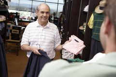 Senior Man Buying Clothes Royalty Free Stock Photography