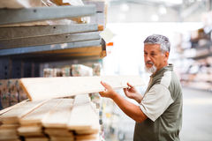 Senior man buying construction wood Royalty Free Stock Photography