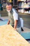 Senior man buying construction wood Royalty Free Stock Photography