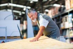 Senior man buying construction wood Royalty Free Stock Images