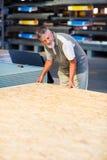 Senior man buying construction wood Stock Photos