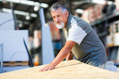 Senior man buying construction wood Royalty Free Stock Image