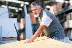 Senior man buying construction wood Royalty Free Stock Image