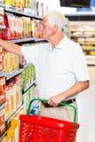 Senior man buying food Royalty Free Stock Image