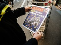 Senior man buying press newspaper kiosk press about european elections. Paris, France - 29 Mar 2019: Newspaper stand kiosk selling press with senior male hand royalty free stock image
