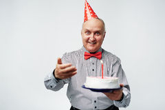 Senior man with cake Stock Photography
