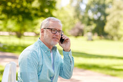 Senior man calling on smartphone at summer park Royalty Free Stock Photography