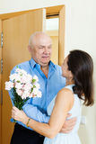 Senior man came to mature woman Stock Image