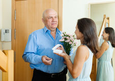 Senior man came to mature woman Stock Photos