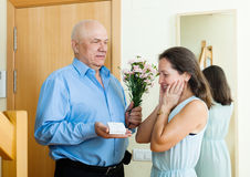 Senior man came to  woman with present Stock Photos