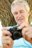 Senior man with camera Royalty Free Stock Photography