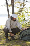 Senior man camping Royalty Free Stock Images