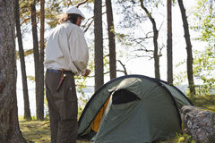 Senior man camping Stock Images